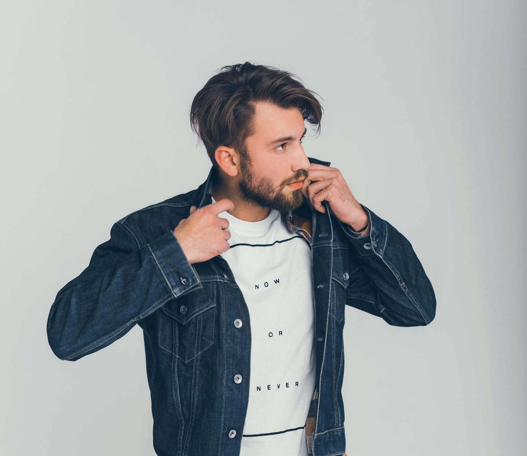young beard  man posing in the studio